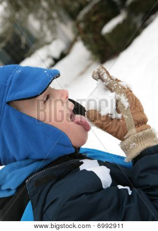 Boy Tasting Snow