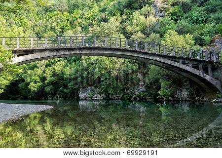Bridge In Bright Forest Of Voidomatis River That Flows Through Epirus Region, Greece. Natural Compos