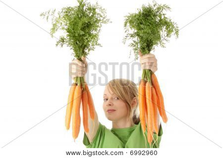 Fitness Young Woman And Carrots