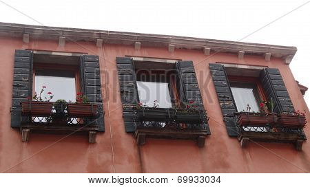 Windows with jalousies in Venice, Italy