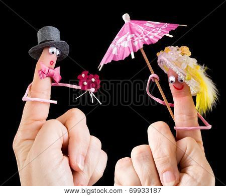 Caricature made of a finger puppet representing a valentine couple