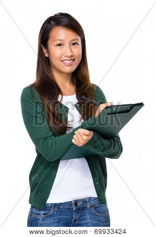Asian young woman write on clipboard