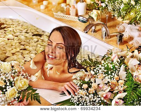 Woman relaxing at water spa.