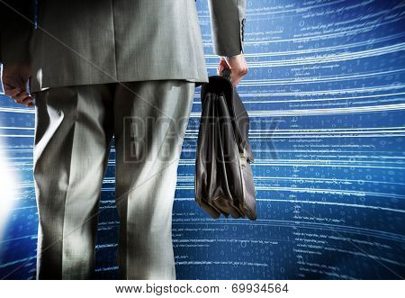 Rear view of businessman with suitcase and digital background