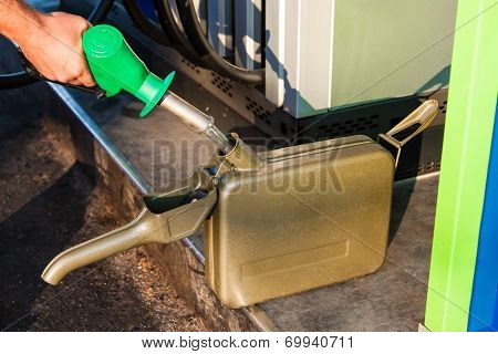 Man Filling Canister With Petrol