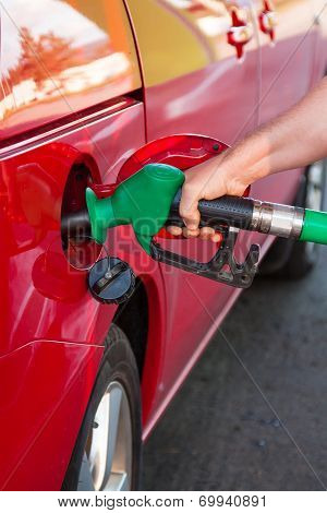 Person Refueling A Car At Gas Station