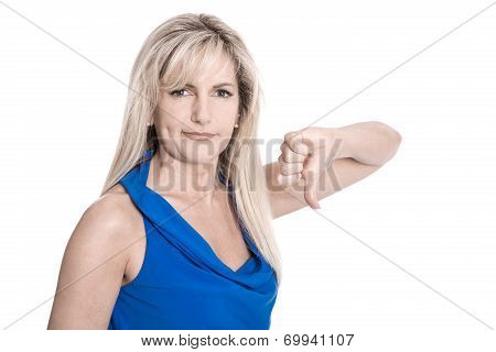 Disappointed Isolated Middle Aged Woman In Blue Shirt With Thumbs Down.