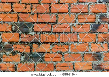 Wire meshing and Red brick wall