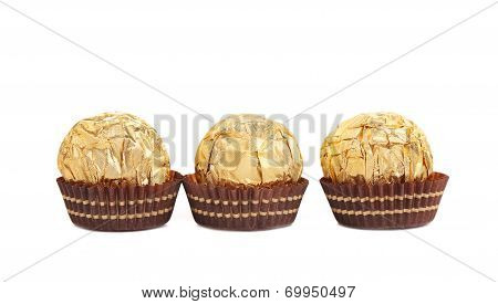 Three in row chocolate bonbons.