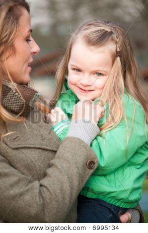 Smiling Girl On Mother's Hands