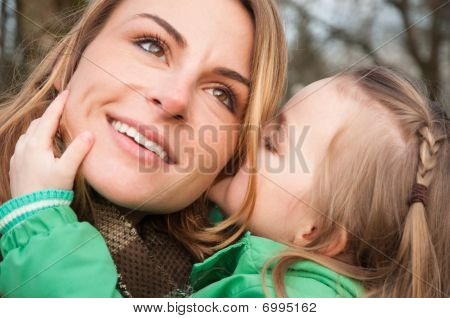Woman Listnening Her Daugther With Smile
