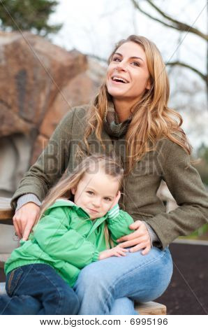 Smiling Young Woman With Daughter