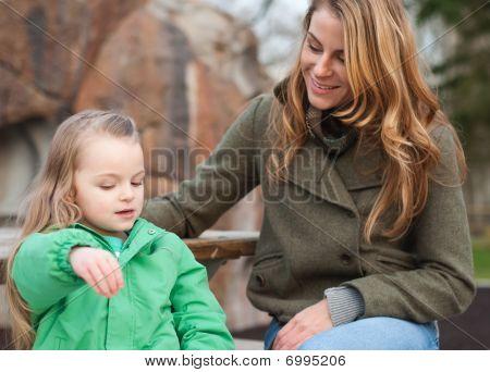 Little Girl Storytelling To Her Mom