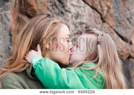 Kissing Mother And Daughter