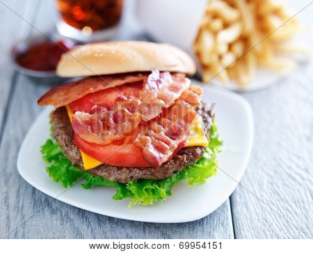 bacon cheeseburger with fries and cola