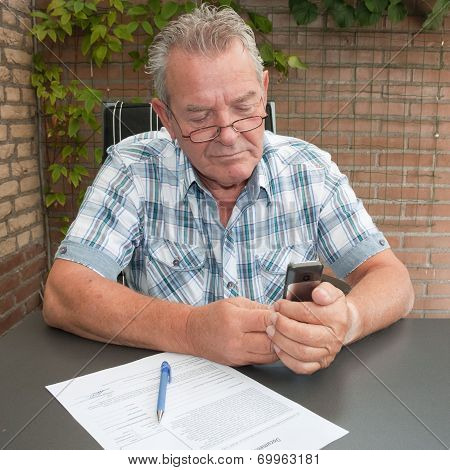 Senior Searching In His Mobile Phone