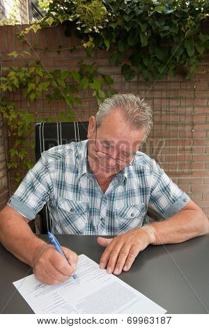 Senior Signing A Legal Contract