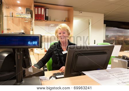 Senior Volunteer Female Cashier At Museum