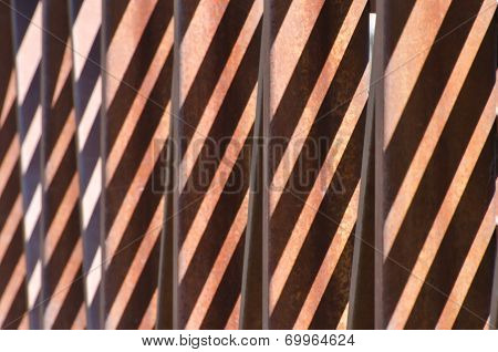 Abstract - Diagonal Shadow Pattern On Rusty Bridge Girders