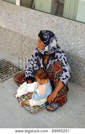 Woman beggar asking for money in Kusadasi, Turkey