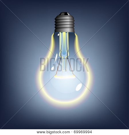 glowing lightbulb on dark background