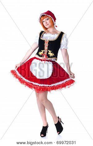 Pretty model posing as Little Red Riding Hood