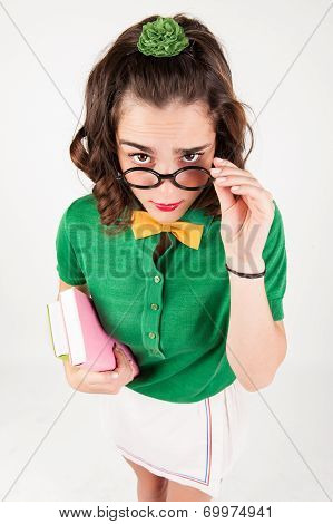 Nerdy Girl Holding Spectacles Looking Up.