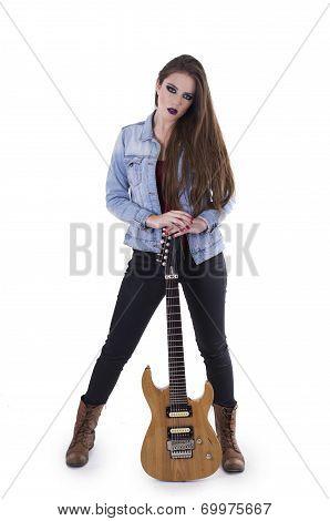 Gogeous blond rocker girl posing holding electric guitar