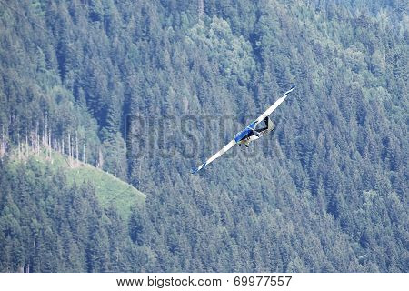 Glider During The Course Of Training Exercise Flying Over The Mountains In Leoben, Austria.