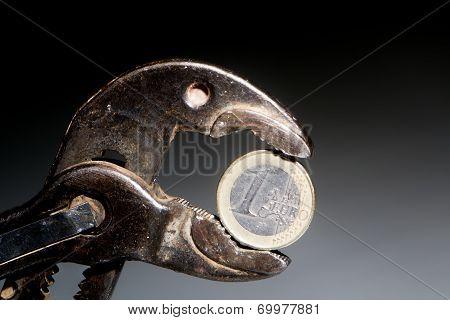 Greek Euro Coin In Rusty Pliers