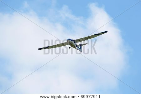 Glider During The Course Of Training Exercise Flying Against Blue Sky In Leoben, Austria.