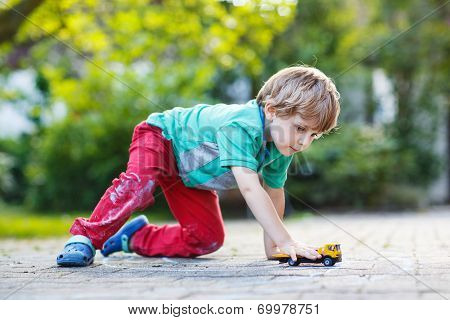 Little Toddler Boy Playing With Car Toy