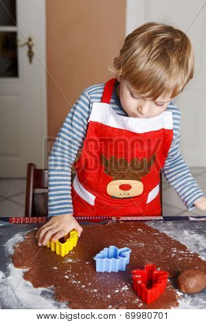 3 Years Child Baking Ginger Bread Cookies For Christmas