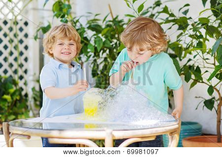 Two Happy Children Making Experiment With Colorful Bubbles