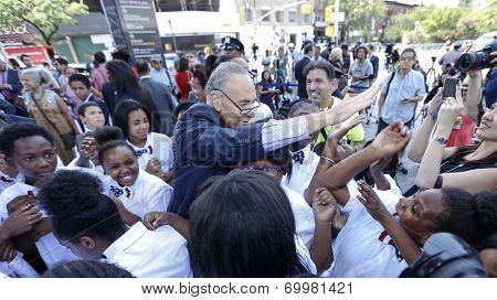 Senator Schumer high-fiving kids