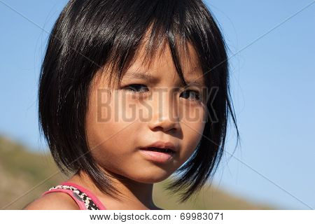 Fisher kid with brown skin and reflect eyes at Binh Ba island, Khanh Hoa province, Vietnam