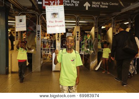 Boy with breastfeeding sign underground