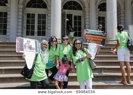 Diverse moms in front of City Hall steps