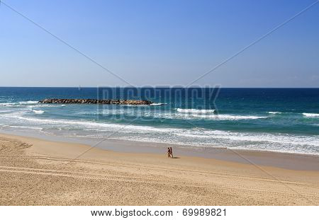 Couple Walking on the Beach Beside the Mediterranean Sea