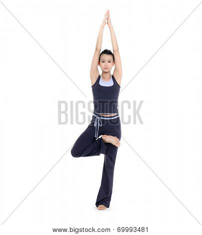 Full body young woman stand in yoga pose