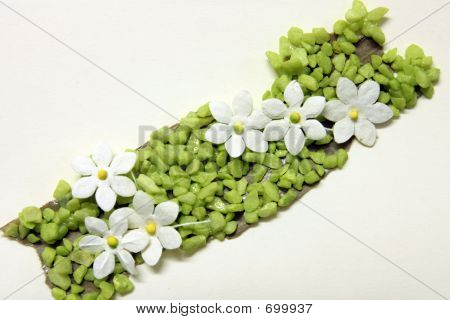 Handicraft Flowers On A Card.