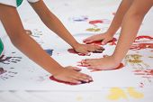 stock photo of nursery school child  - Cute little boys painting on floor in classroom at the nursery school - JPG