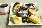 foto of portobello mushroom  - Balsamic marinated portobello mushrooms with grilled slices of polenta arugula and shaved parmesan with a balsamic reduction - JPG