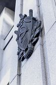 foto of hammer sickle  - Star hammer and sickle symbols of USSR on facade of grey house