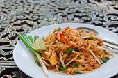 image of lame  - A plate of fried noodle with shrimp in Thai Style on the table - JPG