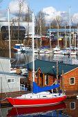 image of bayou  - A red sailboat moored in a bayou - JPG