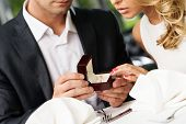 picture of dress-making  - Man holding box with ring making propose to his girlfriend - JPG