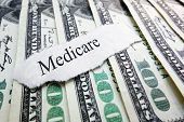 image of medicare  - A Medicare newspaper headline on assorted money - JPG