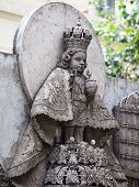 stock photo of cebu  - Statue in the courtyard of the old catholic church of the Basilica del Santo Nino - JPG
