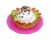 foto of cake-ball  - Cake basket with white cream decorated with small balls - JPG